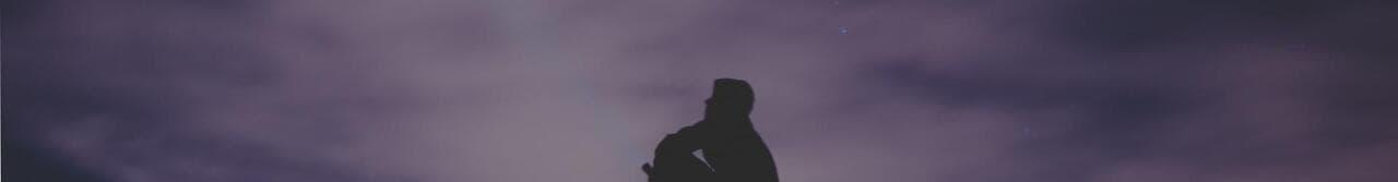 man in mountain during night